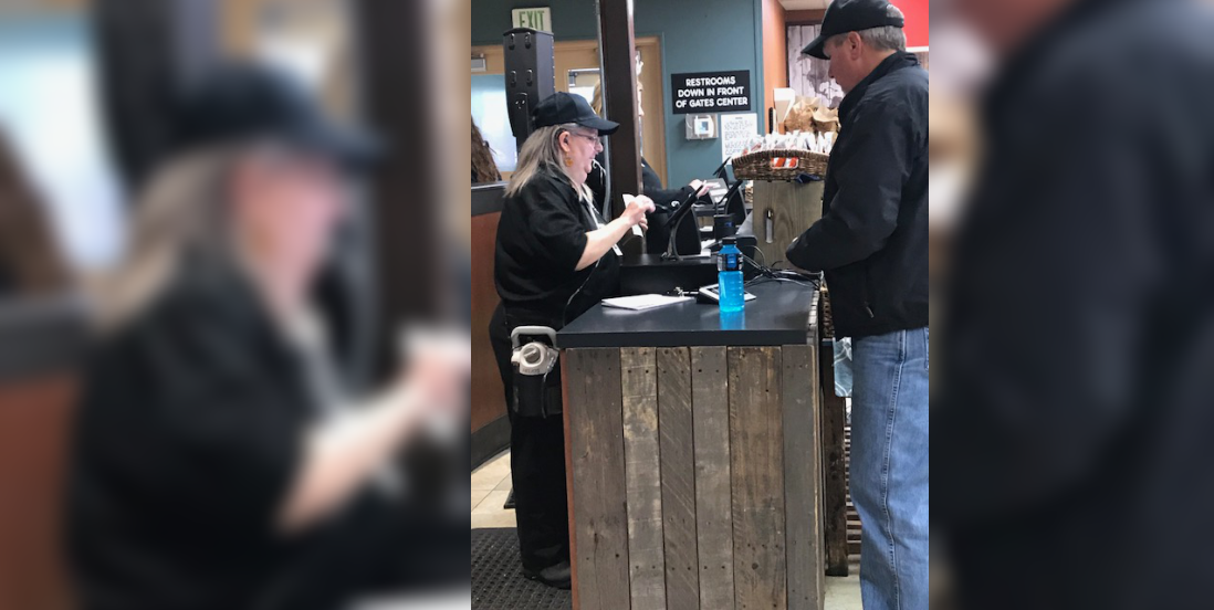 Woman in the cashier with customer